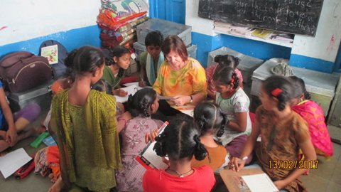 sitting with the students in their classrom